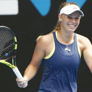 Aus Open PHOTOS: Wozniacki romps into quarters; Navarro rallies