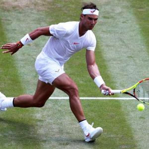 Old-style Wimbledon lawns would have snagged Nadal, says Laver