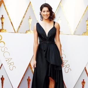 Che Bella! Wimbledon champ Muguruza scorches red carpet at the Oscars!