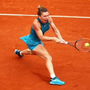 French Open PIX: Halep rallies to advance, Kvitova through