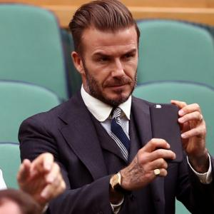 Beckham gets six-month driving ban for using phone