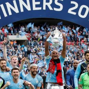 Manchester City crush Watford to complete treble in style