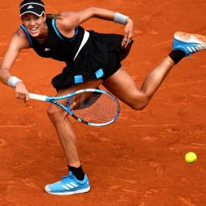 French Open PIX: Muguruza advances; Pliskova shocked
