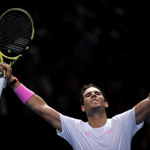 Nadal battles from brink to beat Medvedev