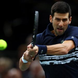 Djokovic sees off Edmund; Barty in WTA Finals semis