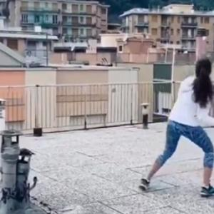 SEE: Italians take to rooftop tennis amid lockdown