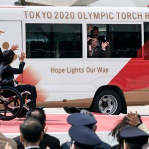 Crowds again greet Olympic flame amid virus concerns
