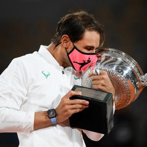 Nadal continues Paris reign with record-equalling Slam
