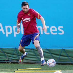 Messi back in training with Barca after departure saga
