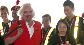 IMAGES: 'Stewardess' Richard Branson fired by AirAsia chief