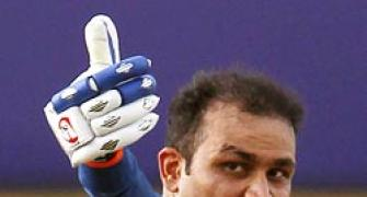 Sehwag's ton helps India storm into final