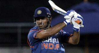 Dhoni century lifts India to victory