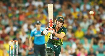 Warner blazes as Australia ease past England in tri-series opener