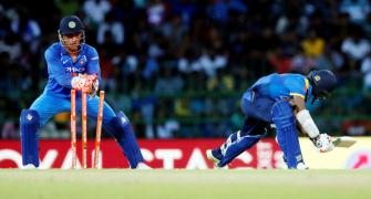 Dhoni strikes record with 100 stumpings in ODIs