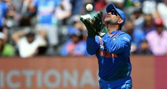 Twin world records for Dhoni in India's T20 win