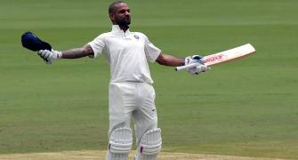 Dhawan joins Bradman with century before lunch on Day 1