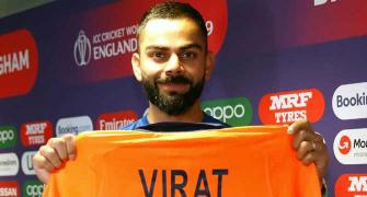 Captain Kohli gives thumbs-up to new orange jersey
