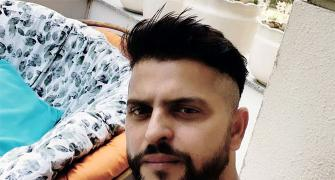 Suresh Raina gets a haircut from wife Priyanka