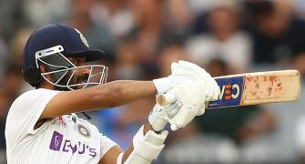 Rahane defies weight of captaincy, draws Kohli praise