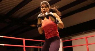 Boxer Zareen stuns world champ to enter quarters