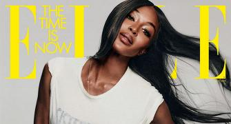 Is Naomi Campbell wearing just a T-shirt?