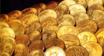 Gold glitters with second biggest gain in 2011; up by Rs 1,025