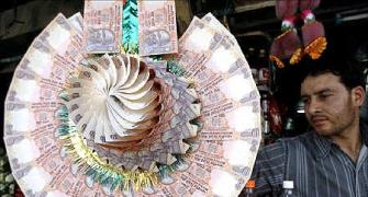 Rupee ekes out marginal rise vs dollar