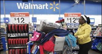 Wal-Mart profits may be hit by overseas bribery probe