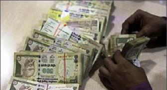 Rupee declines by 13 paise against dollar