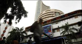 Markets lacklustre at close; banks, capital goods slump