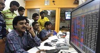 Sensex loses over 100 points; RIL down 1%