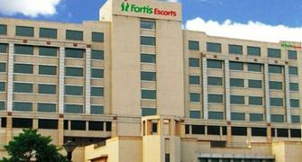 Fortis shareholders vote out director, shadow over sale