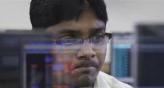 Sensex tanks over 450 points; power, metal stocks sink