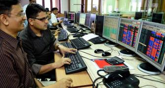 Sensex surges 506 pts to close at record high