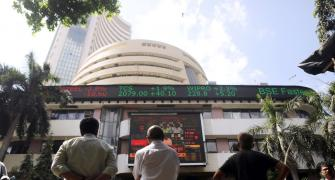 Nifty hits new peak, Sensex rises marginally