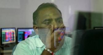 Sensex tumbles 300 pts; Nifty ends below 11,200