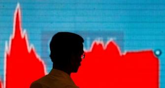 Sensex tanks 883 pts as rising COVID cases spooks mkt