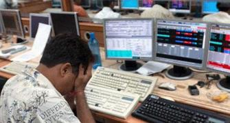 Sensex tanks 938 points; Nifty crashes below 14,000