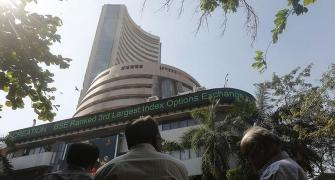 Sensex pares gains; energy, IT shares save the day