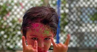 Taimur plays Holi!