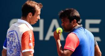 Paes, Sania toil before progressing at US Open