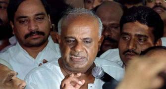 Deve Gowda, grandson Nikhil lose, Prajwal wins