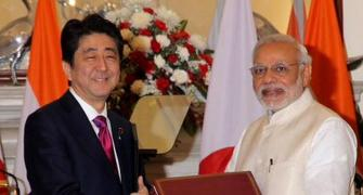 Modi, Japan's Shinzo Abe put bullet train on track, sign defence agreements