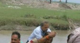 Photo of cop carrying BJP MLA on back goes viral