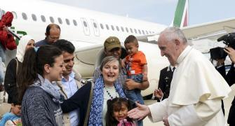'You are not alone': Pope brings 3 refugee families from Greece to Rome