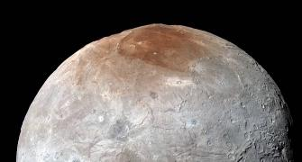 Pluto 'paints' its largest moon red: NASA