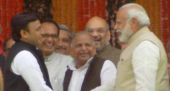 PHOTOS: After trading barbs, PM shares light moment with Akhilesh