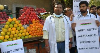 Why are these doctors selling fruits?