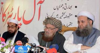 Imran Khan's minister shares stage with terrorist Hafiz Saeed