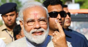 PM Modi votes, says 'voter ID' more powerful than IED